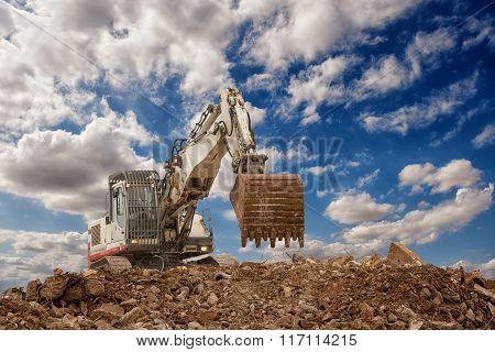 excavator with bucket on gravels