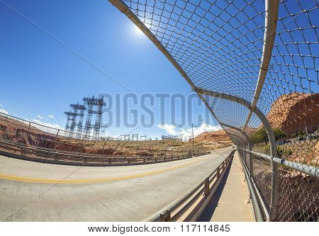 Fisheye Lens Photo Of Road And Energy Infrastructure Against Sun.