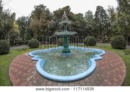 TARGU-JIU, ROMANIA-OCTOBER 08: Fountain in Central Park  on October 08, 2014 in Targu-Jiu. Fisheye view.