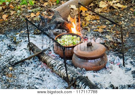Roast In A Clay Pot Over Charcoal