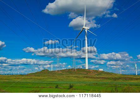 Eco Wind Power Generator On The Grassland