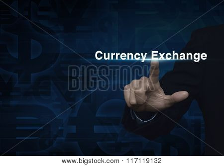 Businessman Hand Pushing Currency Exchange Word On Dark Blue Currency Background