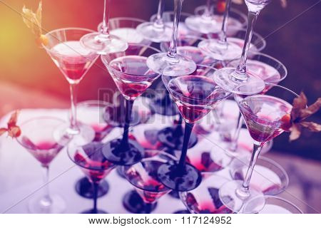 Pyramid Of Champagne Glasses With Color Cocktails