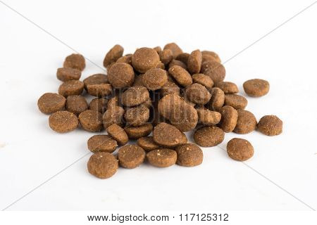 Dried Cat Or Dog Food Isolated On White