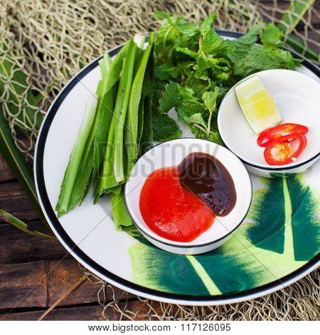 Sauce for Pho Vietnamese Beef noodle soup Hoisin Sauce, Hot sauce on wooden background