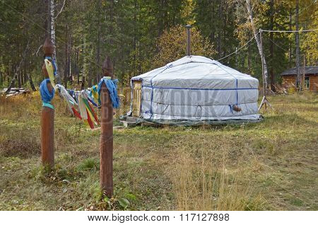 Nomadic yurt for tourists on hiking trail camp in autumn
