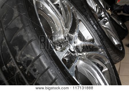 Car Service. The Worker Washes Rims