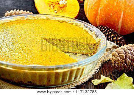 Pie pumpkin in pan on board