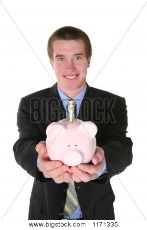 Business Man With Money (Focus On Piggy Bank)