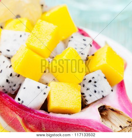 Tropical fruit salad in pitahaya, mango, dragon fruit bowls with a glass of juice Diet, healthy frui