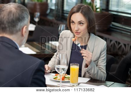 Cheerful colleagues have a meeting in restaurant