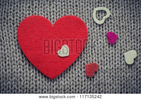 Red Felt Heart And  Colorful Decorative  Hearts With Woollen Texture In The Background