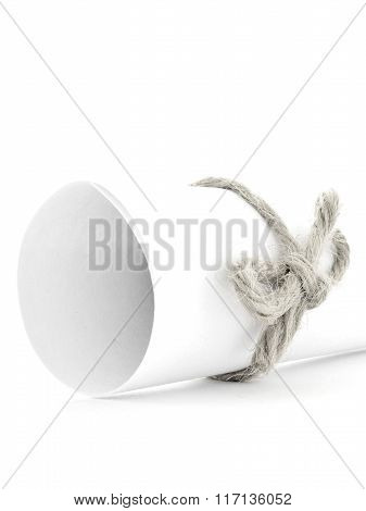 Handmade Natural String Node Tied On White Paper Roll Isolated
