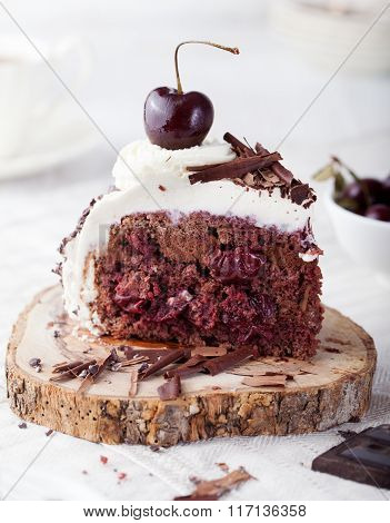 Black forest cake ,decorated with whipped cream and cherries Schwarzwald pie, dark chocolate and che