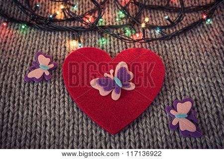 Red Felt Heart, Colorful Garland With Woollen Texture In The Background