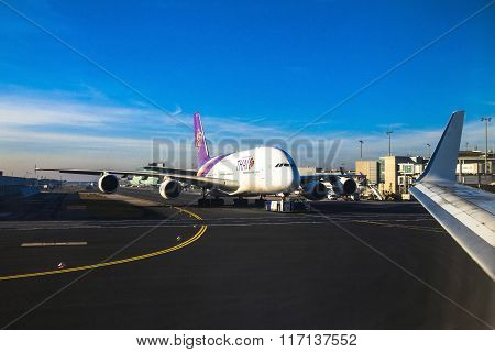 Thai Airways Airbus A380 In Frankfurt Am Main Airport In The Bright Rays Of The Winter Sun