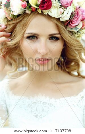 Emotional Touched Beautiful Blonde Bride In White Dress In Wreath With Make-up Close-up