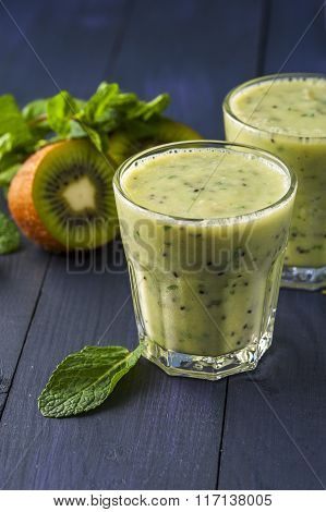 Glasses of homemade smoothie with kiwi, banana and mint leaves