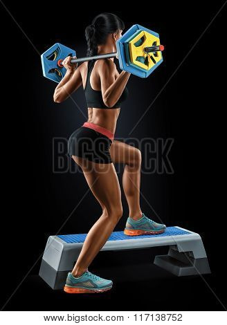 Strong Young Woman With Athletic Body Doing Exercises With Barbell