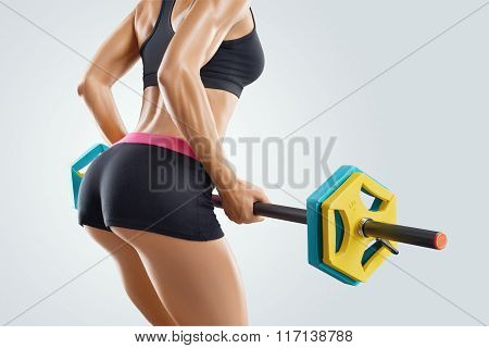 Close Up Photo Of Fitness Woman Workout With Barbell At Gym