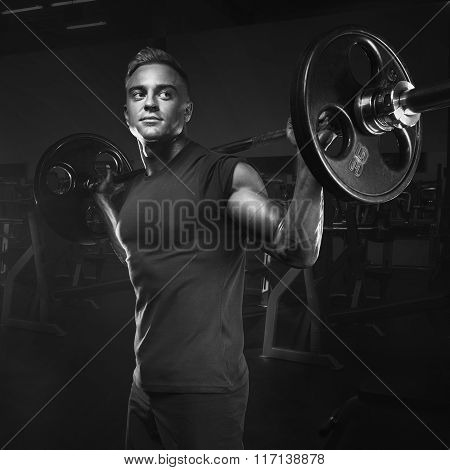 Muscular Man Training Squats With Barbells Over Head