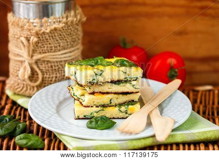 Traditional Breakfast - Frittata with spinach and cheese. Rustic style