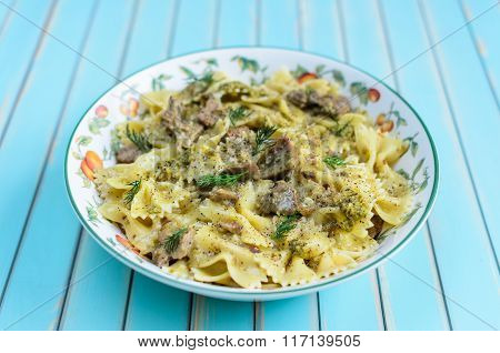 Pasta With Grilled Turkey, Pesto Sauce And Fennel In Serving Plate Over Wooden Turquoise Background