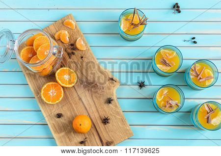 Homemade Tangerine Jelly In Glasses Over Wooden Rustic Turquoise Background