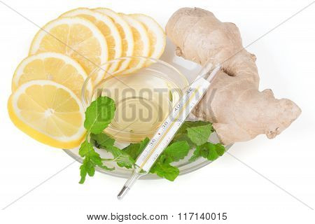 Slices Of Lemon, Ginger And Honey With A Thermometer