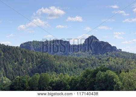 Group Of Rocks Schrammsteine And Falkenstein And Blue Sky In Saxon Switzerland