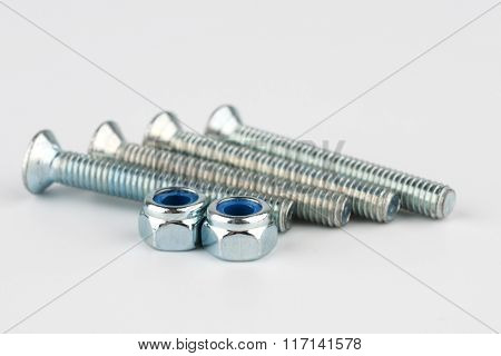 Two Shiny Metal Screws And Nuts
