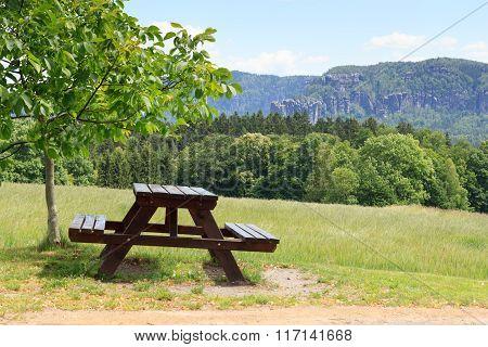 Bench And Rocks Affensteine With Blue Sky In Saxon Switzerland
