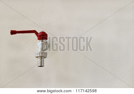 Faucet Valve On Wall Background