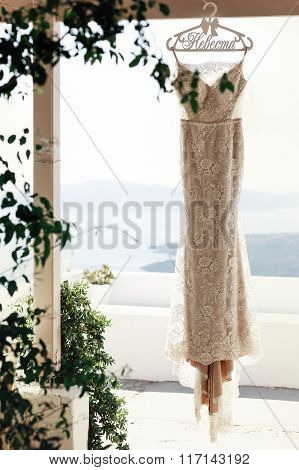 Elegant Vintage White Dress Hanging On Terrace With Sea In Background