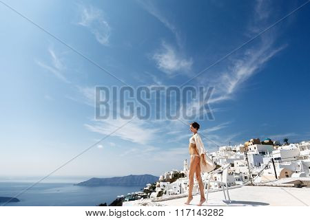 Sexy Brunette Female Bride In Lingerie In Santorini With Sea And Mountains In Background