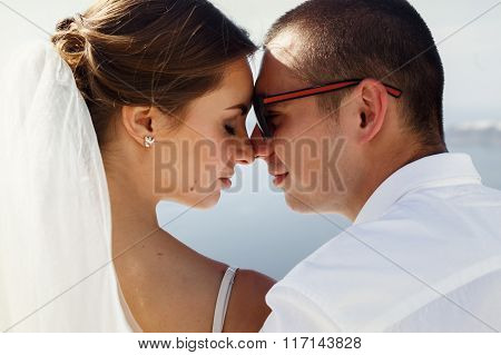 Happy Married Couple Kissing On Terrace With Sea And Mountains Background, Santorini Closeup