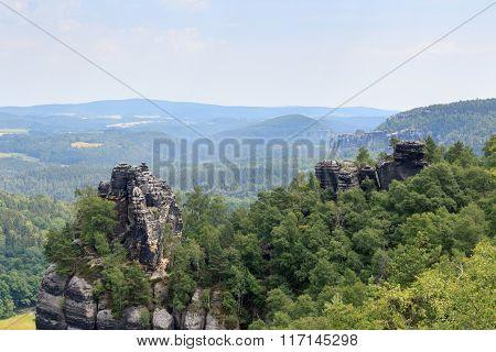 Panorama With Group Of Rocks Affensteine Seen From Schrammstein Viewing Point In Saxon Switzerland