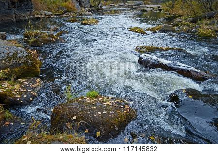 Little seething mountain river with moss stones