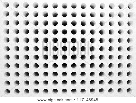 Rows of small holes in styrofoam