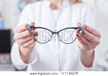 Cheerful female ophthalmologist is working with patient