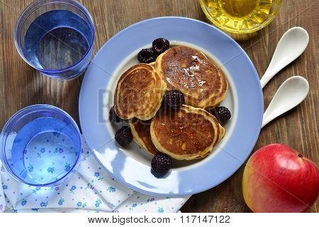 Corn flour pancakes with berries and honey