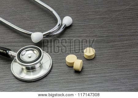 Phonendoscope And Pill On The Table