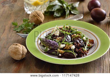 Black rice, arugula, sun-dried plums, walnuts and feta