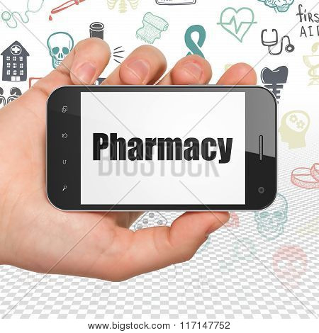 Medicine concept: Hand Holding Smartphone with Pharmacy on display