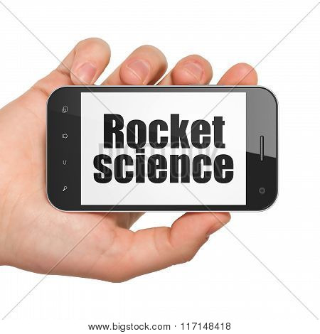 Science concept: Hand Holding Smartphone with Rocket Science on display