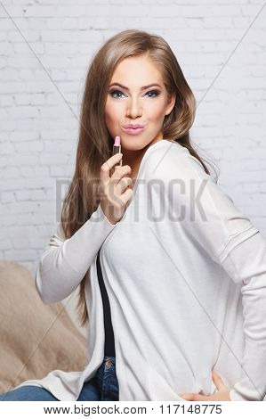 Beautiful Woman holding A Lipstick