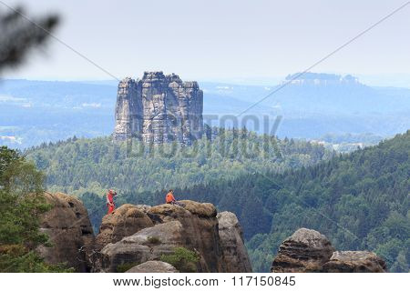 Rock Climber In Front Of The Falkenstein In Saxon Switzerland