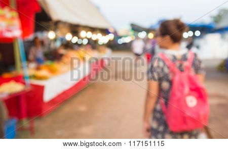 Abstract Blur Background Of People Shopping At Market Fair