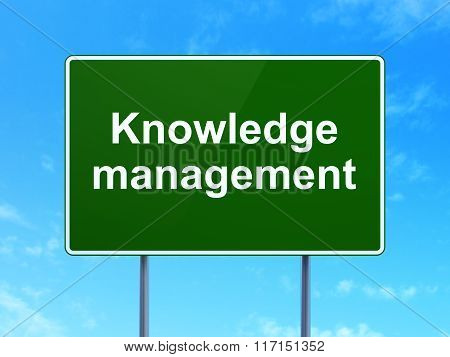 Learning concept: Knowledge Management on road sign background
