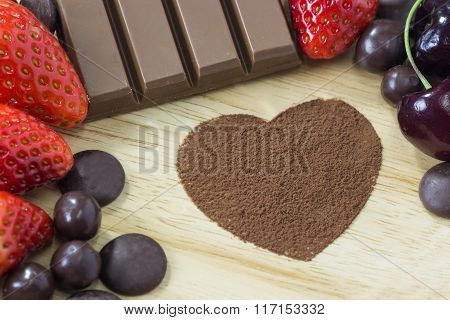 Chocolate And Strawberry On Wood Background And Shape Heart Of Cacao Powder